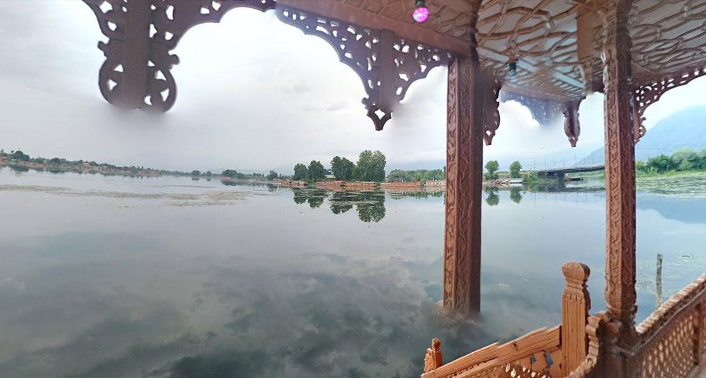 Reflection of clouds in Nagin lake from a Shikara in Srinagar