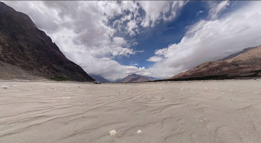 Grey sands on what was perhaps a glacier 100s of years ago, the sense of space is unbelievable because of the mountains!