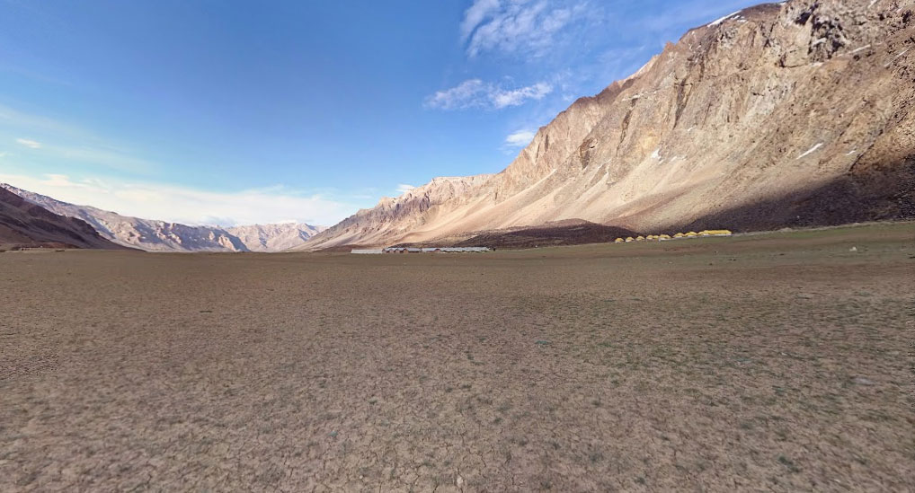 Wide open grazing grounds and camping site of Sarchu at 14,070 ft surrounded by mountains