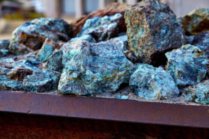 Copper bearing ore on mine conveyor